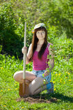 Woman sets tree in garden. Young woman sets tree in garden Stock Photos