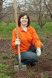 Woman sets tree in  garden Stock Image