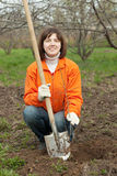 Woman sets tree in  garden. Young woman sets tree in spring garden Royalty Free Stock Photos