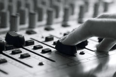 Woman sets up the mixer to adjust the sound and recording Royalty Free Stock Photos