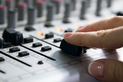 Woman sets up the mixer to adjust the sound and recording Royalty Free Stock Image