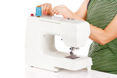 Woman is sets up the sewing machine Royalty Free Stock Photos