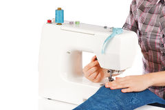 Woman is sets up the sewing machine Stock Photos
