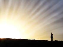 Woman in Setting Sun Stock Image