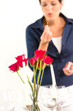 Woman setting table romantic dinner roses Valentine's Stock Images