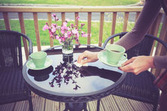 Woman setting table for tea outside Royalty Free Stock Photo