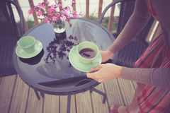 Woman setting table for tea outside Royalty Free Stock Photos