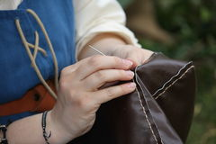 Woman sew a dress Royalty Free Stock Photography