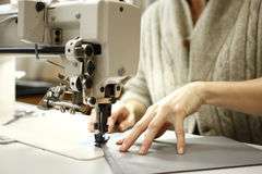 Woman sewing Royalty Free Stock Photography