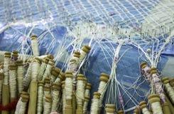 Woman sewing bobbins royalty free stock image