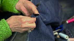 Woman sewing button stock video footage