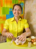 Woman sewing  chicken by toothpicks Stock Photo