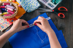 The woman sewing the clothing. Royalty Free Stock Photos