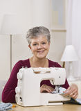 Woman on Sewing Machine Royalty Free Stock Images