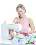 Woman at the sewing machine Stock Images