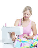 Woman at the sewing machine Royalty Free Stock Image