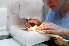 Woman at the sewing machine Stock Photo