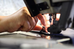 The woman sewing on the machine. Stock Photography