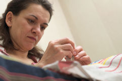 Woman sewing Royalty Free Stock Image