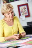 Woman Sewing Quilt Stock Image