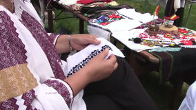 Woman sewing Romanian traditional motif stock footage