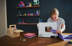 Woman sewing on a sewing machine royalty free stock photo
