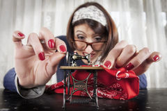Woman sewing with a small sewing machine Royalty Free Stock Photo