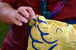 Woman sewing a Tivaevae Stock Photos