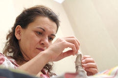 Woman sewing, view from below Stock Photos