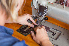 Woman Sews Guitar Wallet Stock Photos