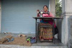 The woman sews Royalty Free Stock Photo