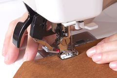 Woman sews Royalty Free Stock Images