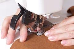 Woman sews Stock Image