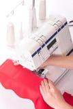 Woman sews Royalty Free Stock Photo