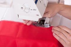 Woman sews Royalty Free Stock Photos