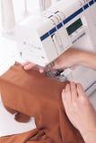 Woman sews Royalty Free Stock Image