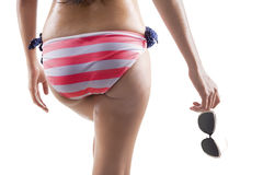 Woman in sexy bikini holding sunglasses Stock Photo