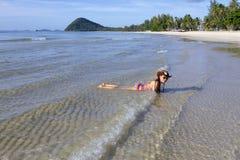 Woman  sexy bikini relax wave sunshine on beach. At Thung Wua Lan Beach, Chumphon Province Thailand Stock Images