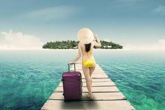 Woman in bikini walking to island 1 Royalty Free Stock Image