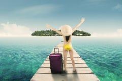 Woman in sexy bikini walking to island 2 Royalty Free Stock Images