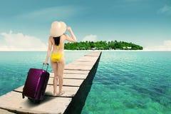 Woman in bikini walking to island Royalty Free Stock Photography