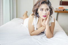 Woman in sexy black lingerie lying on bed Royalty Free Stock Photos