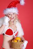 Woman in sexy christmas outfit Stock Photo