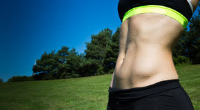 Woman with sexy, fit abs Royalty Free Stock Photos