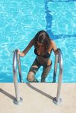 Woman With Fit Body In Fashion Bikini, Swimwear Coming Out From Swimming Pool Water. Beautiful Fashionable Girl With Hot Body stock image