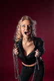 Woman in sexy leather jacket cry with chain Royalty Free Stock Photography