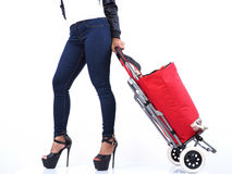 Woman in sexy leggings with red shopping trolley Stock Photo