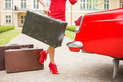 Woman with sexy legs  holding a vintage suitcase Royalty Free Stock Photos
