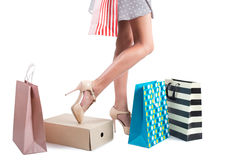 Woman sexy legs with shopping bags. Royalty Free Stock Images