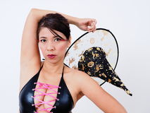 Woman sexy lingerie holds witch hat Royalty Free Stock Image